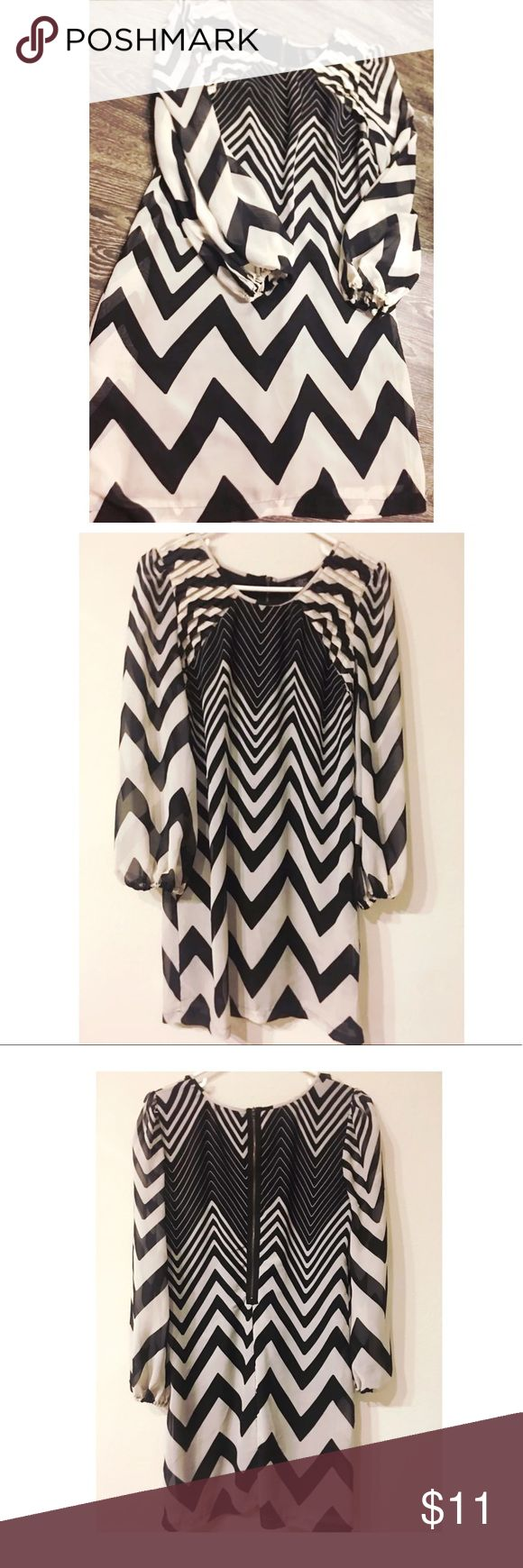 Chevron Print Dress Size Large ◾️▫️Beautiful Chevron Print Dress (black and White)  ✔️Excellent Condition Just like new  🔘Size Large with full sleeves  📏Measurements: bust 19 inches  Length 35 inches   📦📫 Bundles and Offers are accepted Fire Los Angeles Dresses Midi