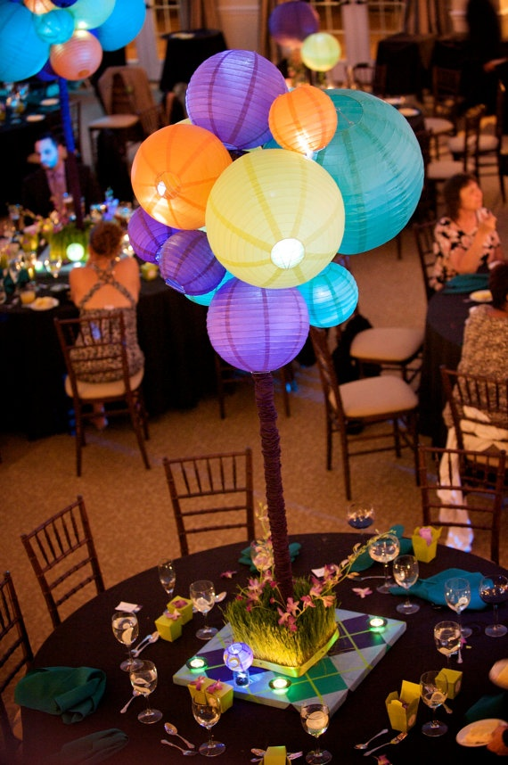 Clusters of paper lanterns suspended from the marquee roof to create a sculptural centre piece. Love the bright colours!