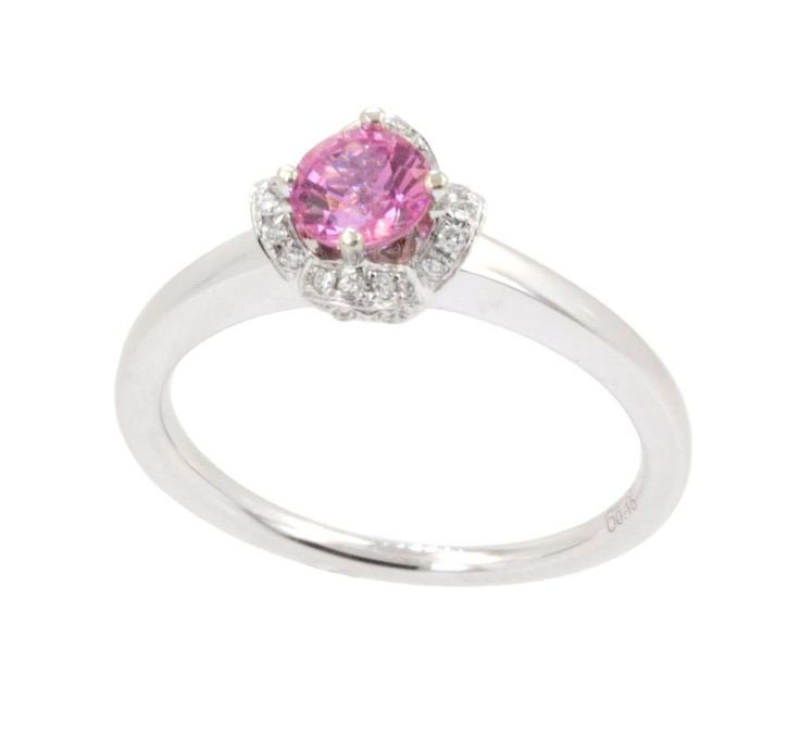 "For the one who loves PINK! A lovely 18k white gold ring with a sweet flower petal setting features 0.15cts of diamonds between 48 stones. The center features a 0.61ct round pink sapphire. This ring could be great for an engagement, birthday, or a just because ""I love you"" gift. Isn't it sweet? www.gembycarati.com www.facebook.com/gembycarati"