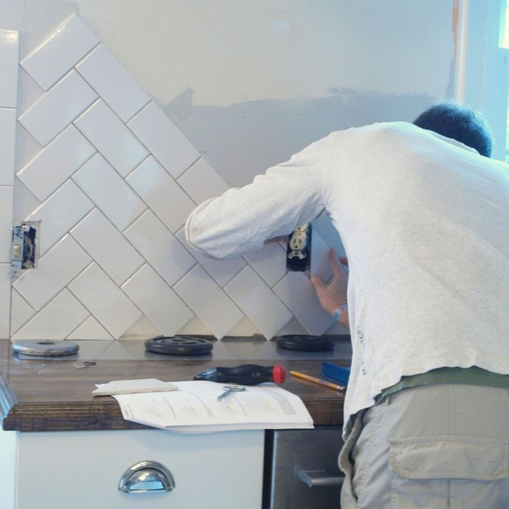 herringbone tile backsplash - cheap and cheerful white subway tiles with black grout