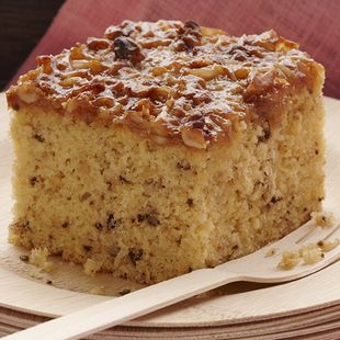 Jamaican Banana Cake: Moist Duncan Hines Banana Supreme Cake Mix with walnuts and coconut delivers a tropical island flavor to your very own kitchen with this Jamaican Banana Cake.