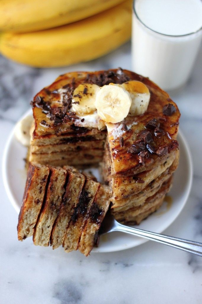 Best Ever Banana Oat Pancakes - these healthy pancakes are made with smashed bananas, greek yogurt, oats, and whole wheat flour! Light, fluffy, and full of perfect pancake qualities - you'd never know they're lightened up!