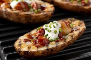 Potato Dog Skins recipe...great idea for a change up on the regular game day hot dog.