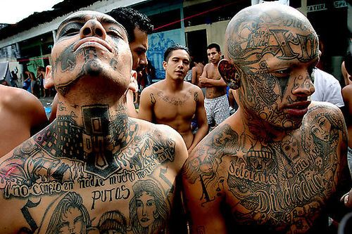 """GUATEMALA GANGS — Gang members hang out at the courtyard inside El Hoyon prison, in Escuintla, Guatemala. A string of violent and mysterious killings targeting gang members and criminals in Guatemala has prompted rumors of a """"social cleansing,"""" an effort to weed out undesirable members of society. Some blame police, others point a finger at vigilante groups sick of rising crime. Police say rival gangs are responsible."""