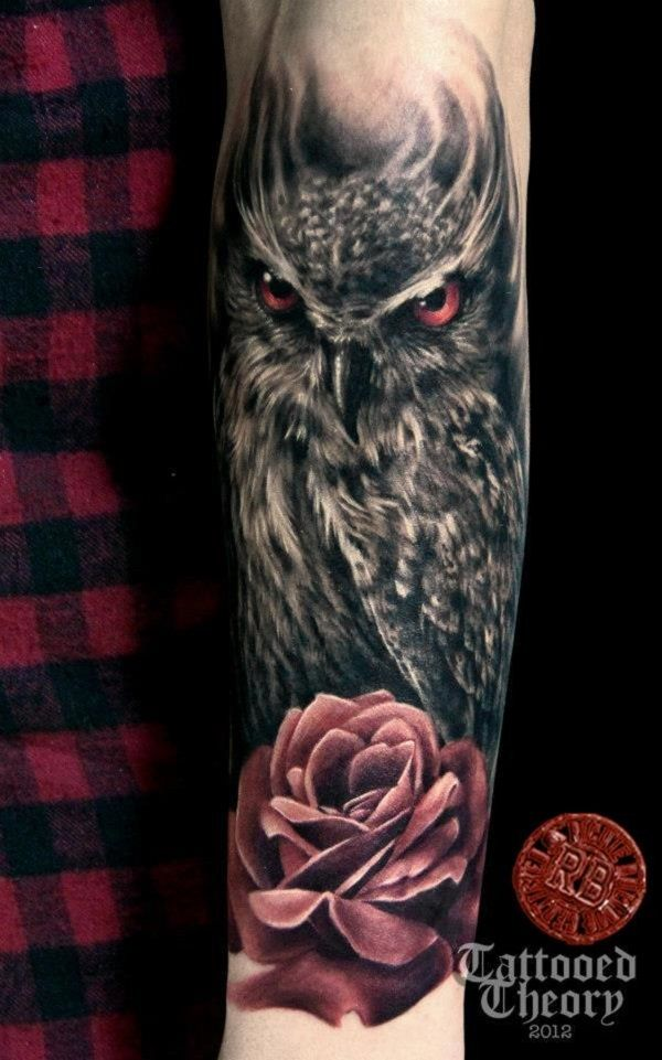 Bird Tattoo by Bluehyper - Bluehyper's mysterious owl tattoo. The owl throws a vicious look with its red eyes matching the red rose which it is also perching on.
