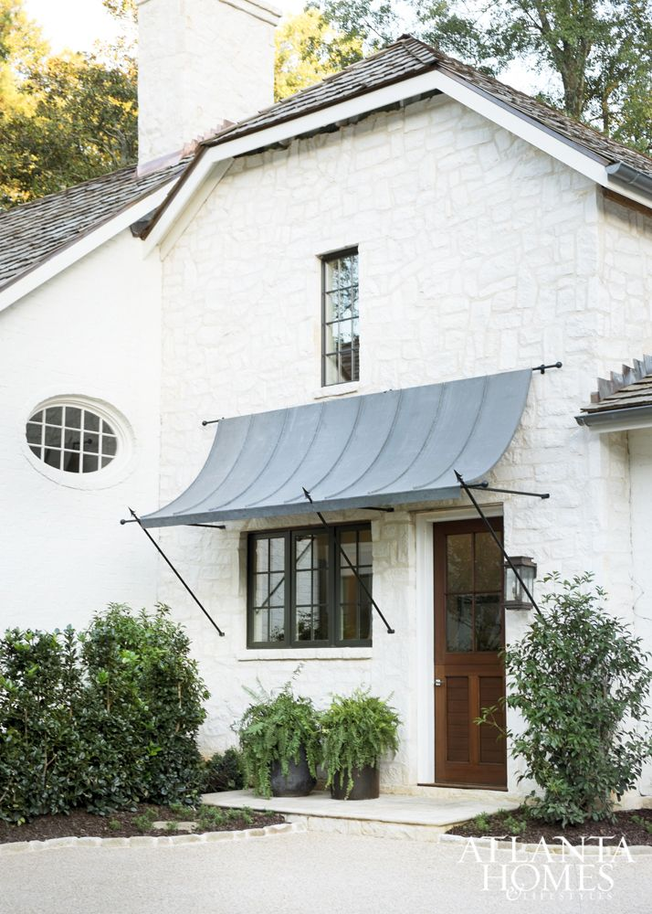 House Tour: Peachtree Park - Design Chic, white painted brick, atlanta homes, metal awning over door and window