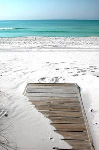 Pensacola Beach, white sand, clear blue water, miles & miles of beach, no waves, unless sadly a storm is brewing.