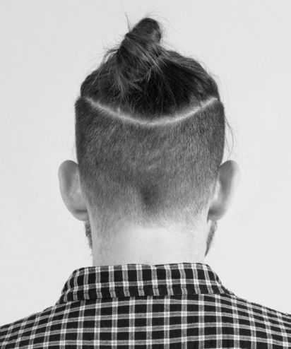 The undercut bun or as others would call it, a top knot is a mixture of two  of the trendiest hairstyles of 2014 , The undercut and the man bun.