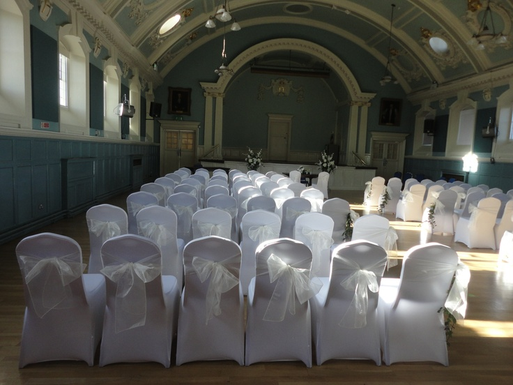 Stretch fitted chair covers with vanilla organsa chair bows for civil ceremony by www.fuschiadesigns.co.uk.