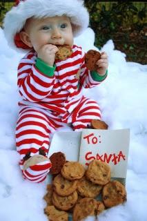 Baby eating santas cookies