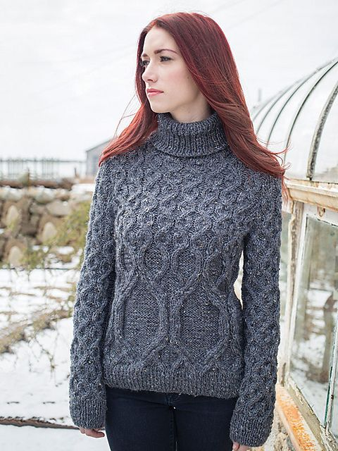 Standing features an evolving cable motif that shifts from hem to shoulder over the body and sleeves of this pullover.