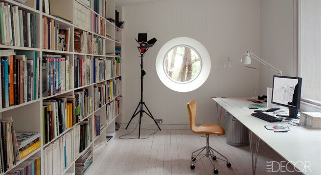 The work studio in one of the annex buildings includes a chair by Arne Jacobsen.