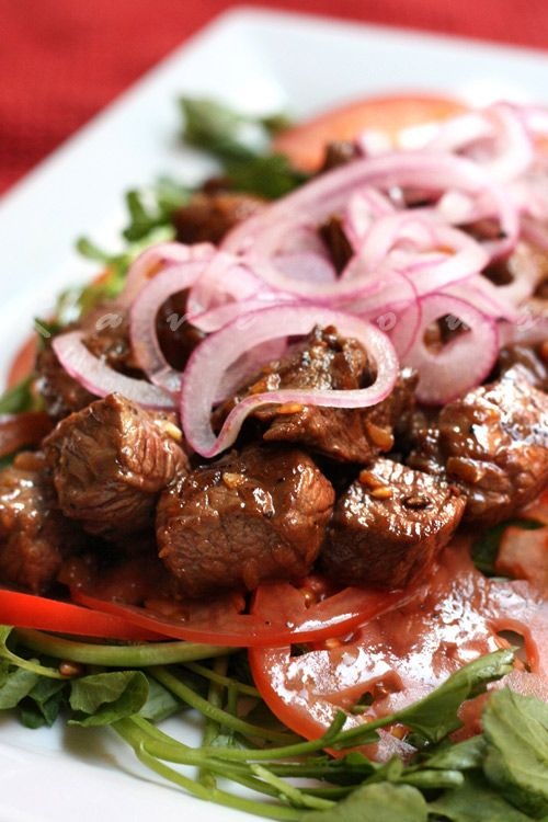 Bo Luc Lac (Vietnamese Shaking Beef) - You can use any cut of steak you like such as filet or ribeye, but we prefer sirloin. Some restaurants serve it with sauteed onions, lettuce, and rice (white or tomato paste rice) while others may present it more like a steak salad served on a bed of watercress and tomatoes, topped with pickled onions.