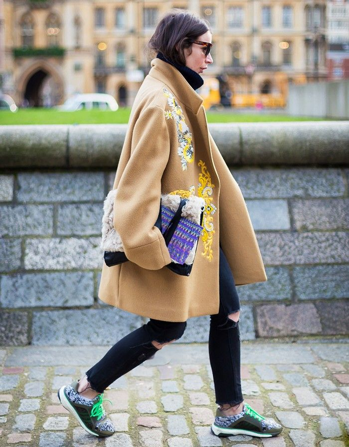 Funky embroidered camel coat + colorful clutch + statement sneakers