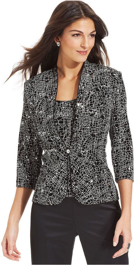 Dressy jackets are a fun way to up the impact factor of a traditional business wardrobe. Pair a dressier jacket with basic women's trousers in jet black for a fun take on business wear. Add color by layering the jacket with a brightly colored shell or cami.