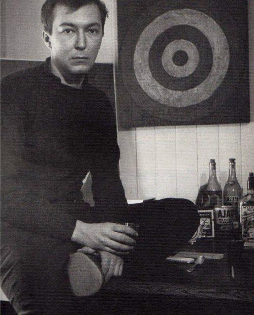 Jasper Johns photographed in his studio by Robert Rauschenberg, 1955.