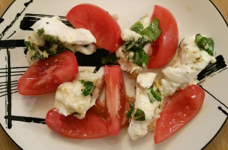 Gemarineerde buffelmozzarella met tomaat