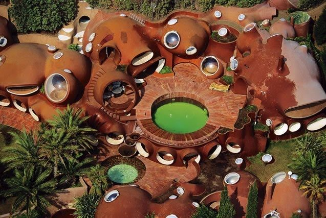 "The Palais Bulles, or ""Palace of Bubbles,"" represents the fundamental ideas of architect Antti Lovag. Built in 1989 and located in the town of Théoule-sur-Mer (10 km outside Cannes), the house overlooks the Mediterranean Sea and the red cliffs of the Esterel, with a panorama stretching to the bay of Cannes."