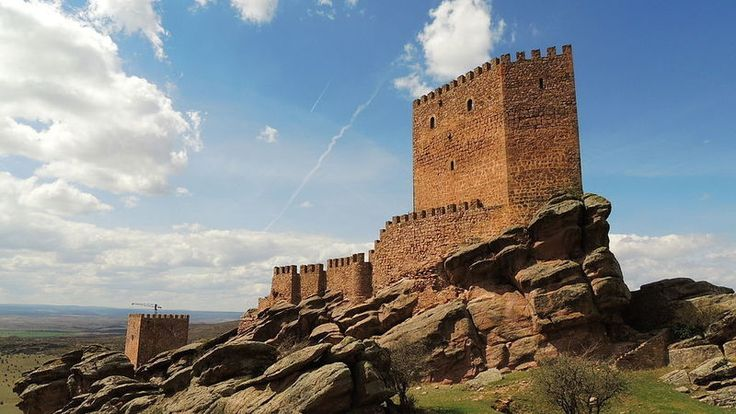 11. Castillo de Zafra--Castellar de la Muele, Spain  Spectacularly perched on a massive sandstone rock, this fantastical, 12th-century Spanish castle is slated to appear in the sixth season of HBO's Game of Thrones.