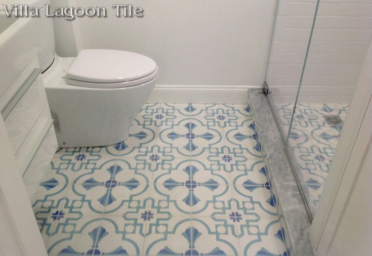 """Our exclusive """"Savona"""" is a cement tile pattern designed for our Coastal Series. Shown here in our coastal """"Palm Beach"""" colorway, this pattern features a barbed quatrefoil full of coastal accents, such as seashells."""