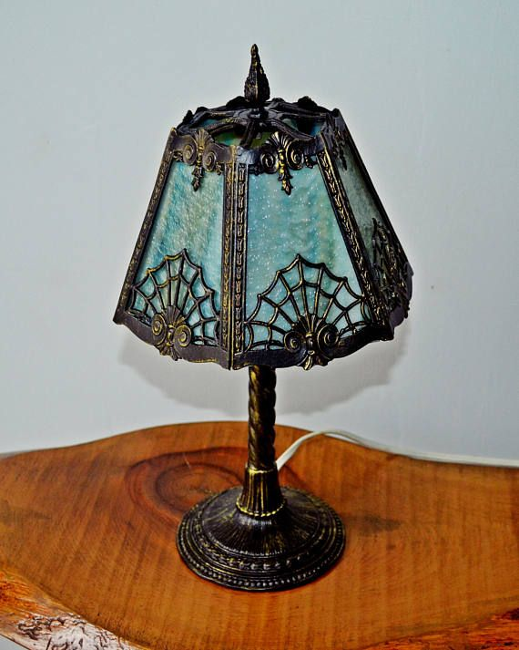Check out this item in my Etsy shop https://www.etsy.com/ca/listing/524655249/slag-glass-boudoir-table-lamp-art