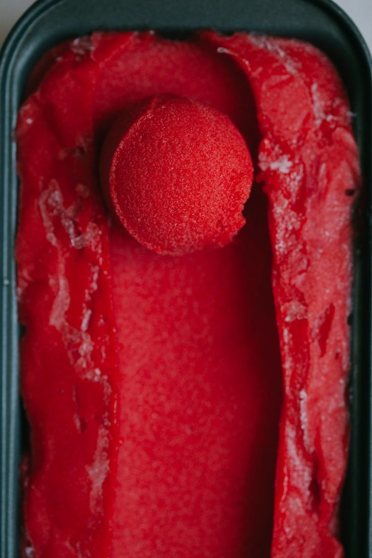 A refreshing and summery Strawberry Thai Basil Sorbet from the My Darling Lemon Thyme Cookbook, combining fresh seasonal berries and aromatic Thai basil.