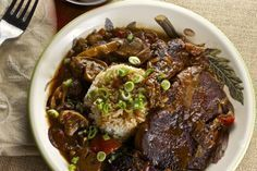 Ribeye steak smothered in a rich gravy.
