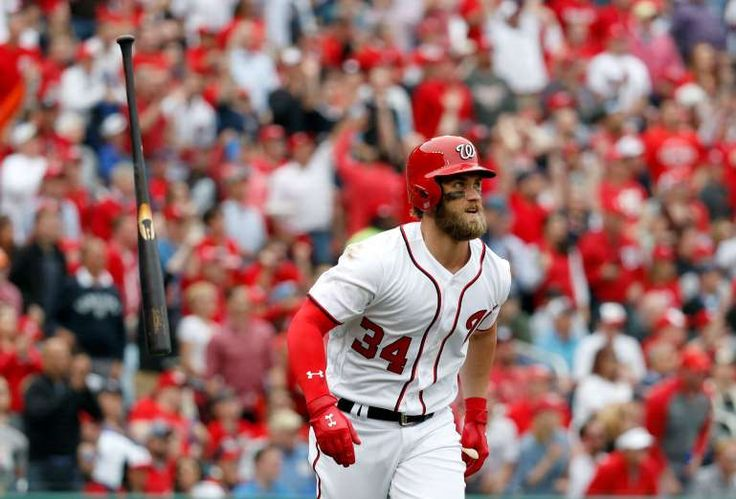 Everything goes according to Nationals' plan in win over Marlins  -  April 3, 2017:    Bryce Harper flips his bat as he watches his solo home run during the sixth inning. - Alex Brandon/Associated Press