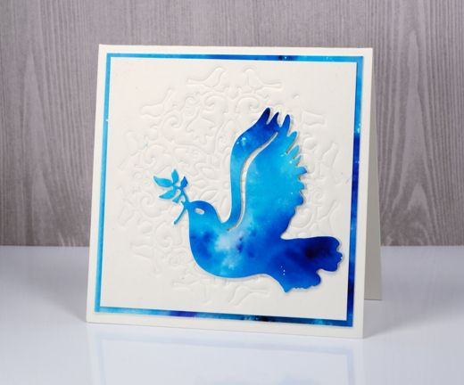 handmade card: More Matelasse by Heather Telford ... technique explained on the blog ... background gets quilted look from cutting plate ... bright white background with bright blues on die cut dove of peace ... great card ...