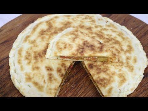 NAAN XXL FARCIE (CUISINERAPIDE) Pour la pâte 50 g de beurre fondu 1 yaourt nature 1/2 cuillère a café de sucre 1/2 cuillère a café de sel 1 cuillère a soupe ...