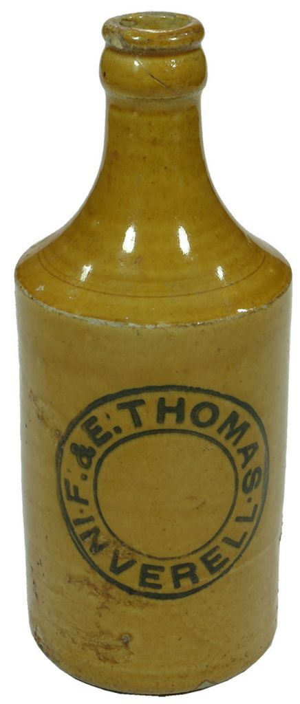F. & E. Thomas, Inverell. Dump shape, all tan, stoneware vintage crown seal ginger beer bottle. c1920