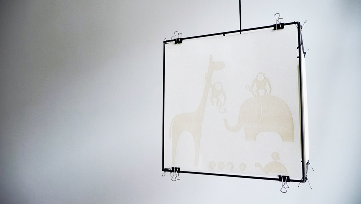 """Lamp """"Juno"""" by Lukas Bast Powder-coated cubic frame. Laser-engraved sheets are fixed with foldback clips."""