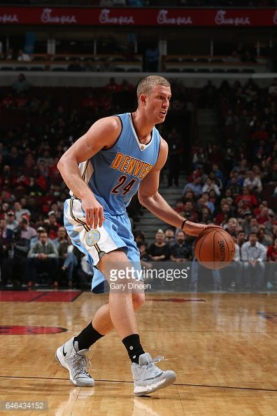 News Photo : Mason Plumlee of the Denver Nuggets handles the...
