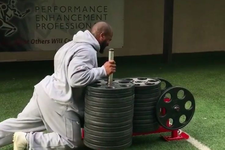 James Harrison's workout involves pushing 1,800 pounds of weights on a sled