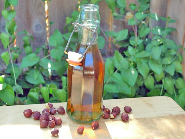 DIY Hazelnut Liqueur  |          1/2 pound raw hazelnuts with skin, roughly chopped (about 2 cups)      1 cup vodka      1/2 cup brandy      1/4 cup sugar      1/4 cup water      1 vanilla bean, split