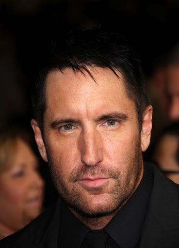 WOW!  When did Trent Reznor get so freaking hot?!. Like a fine wine he just gets better with age!