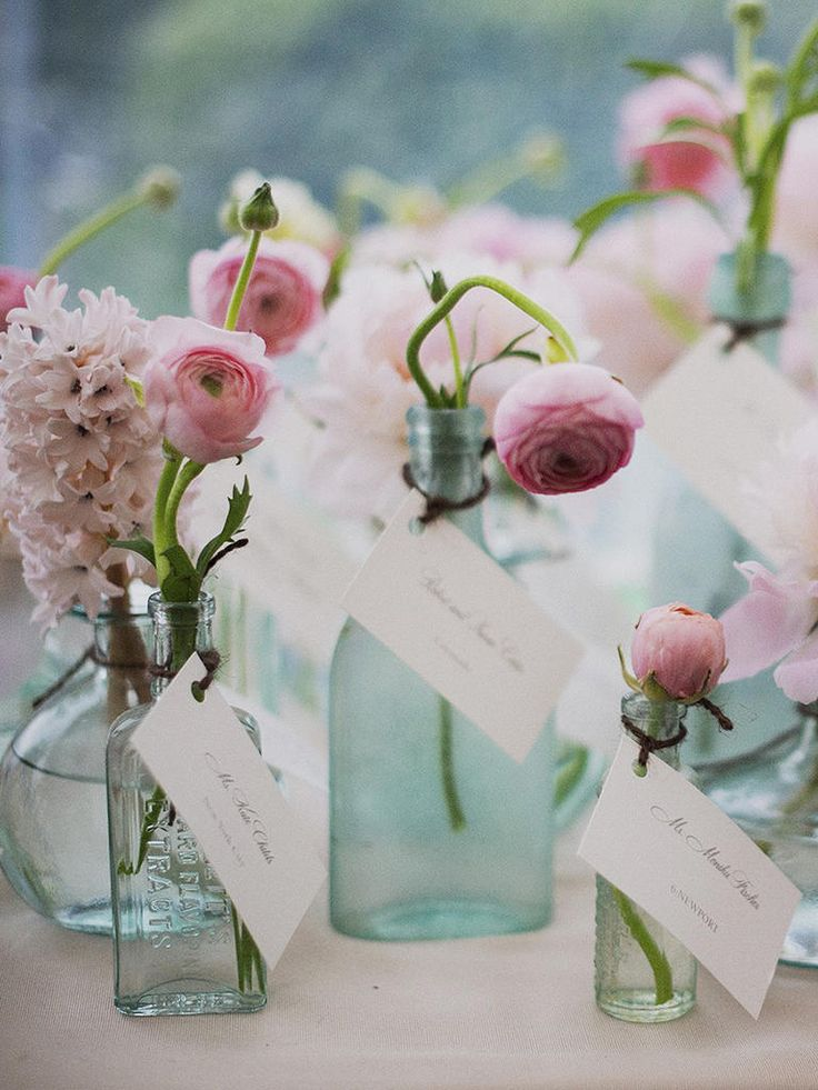 Whimsical bud vase escort card idea