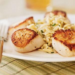 Serve this easy but impressive meal with a green salad, garlic bread, and a crisp white wine. Tip: Sear the scallops while the orzo cooks.
