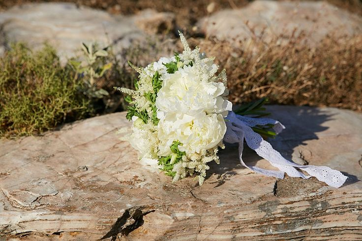 Romantic bridal bouquet composed with white peonies, astilbe, freesia and veronica flowers tied up with happiness :)