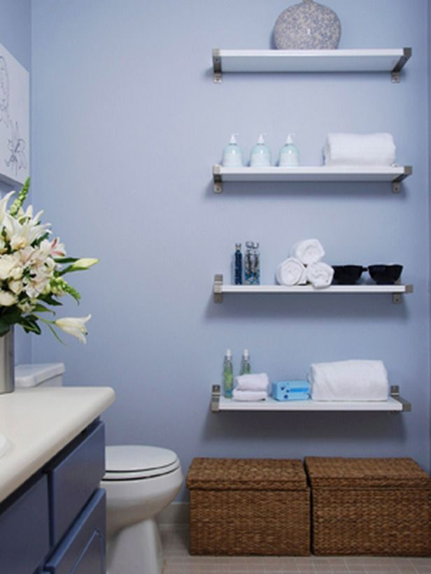 The narrow floating shelves take up little room while providing ample storage space. Plus, it leaves floor space available under the shelves for other storage solutions, like these baskets.