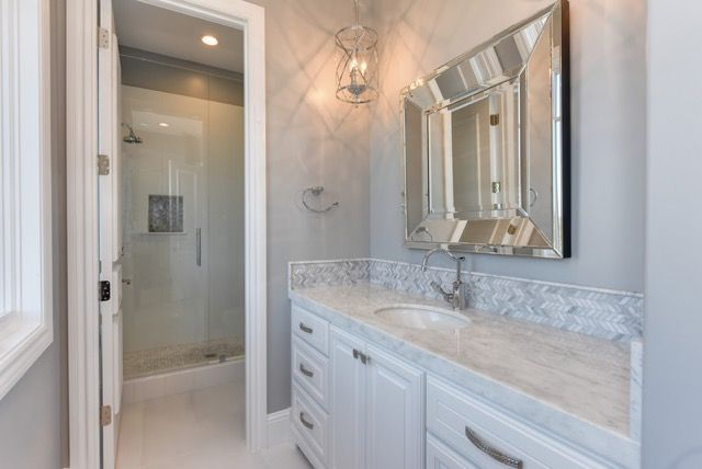 Submission from Anne Sacco Interiors of our Caruso mirror that she used in the guest bathroom of a Hampton's style home in Northern California.