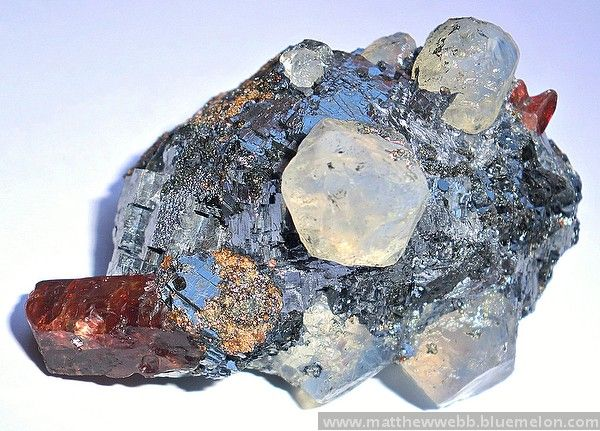 exclusiveminerals > Rhodonite with blue quartz in galena, Broken Hill > Rhodonite with blue quartz and galena