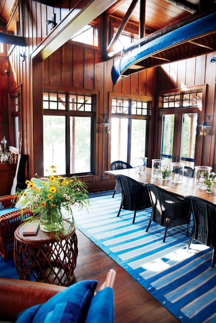Dark wood and an overhead canoe give the dining room a traditional lake-house feel.