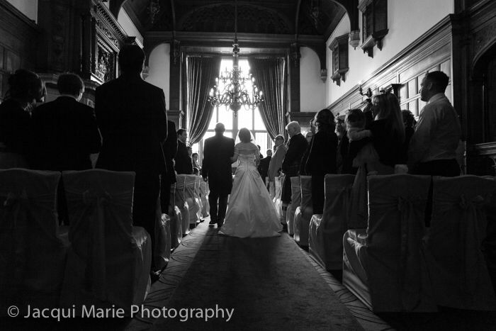 Bride and her father walk up the aisle to her groom at Rhinefield House, by Hampshire wedding photographers Jacqui Marie Photography. See http://jacqui-marie-photography.co.uk for details