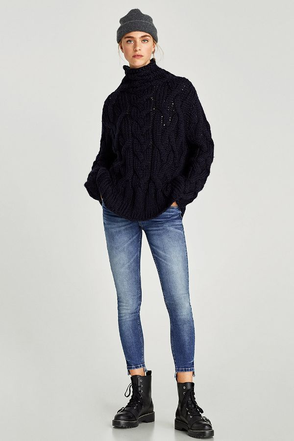 Combat boots are the trend that celebrities can't get enough of this season. The rugged style is perfect for pairing with jeans and oversize sweaters this winter, and that's exactly how Zara is styling them.