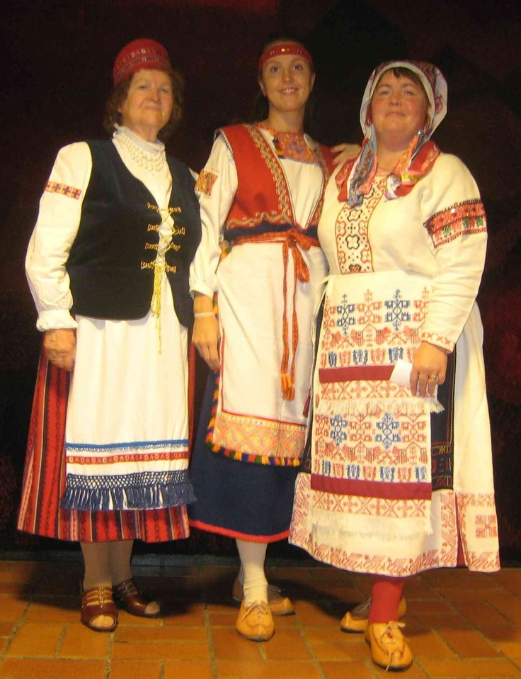 Western Ingria: The woman in the middle is wearing a version of the Tuutteri rekko costume with a misinterpreted sarafan, and the woman on the left is wearing a 'Lutheran Finnish' costume, which is worn by more recent settlers from Finland during the period of Swedish domination.