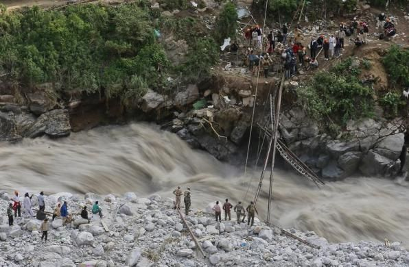 Soldiers try to repair a temporary footbridge over River Alaknanda after it was destroyed, during rescue operations in Govindghat in the Himalayan state of Uttarakhand June 22, 2013. Early monsoon rains have swollen the Ganges, India's longest river, swept away houses, killed at least 138 people and left tens of thousands stranded, local newspapers reported. REUTERS/Danish Siddiqui Posted by floodlist.com #floods #uttarakhand