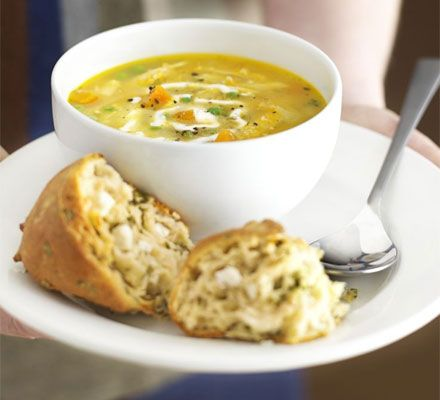 Use up leftover chicken in this rustic soup with garlic cream and cheesy scones on the side