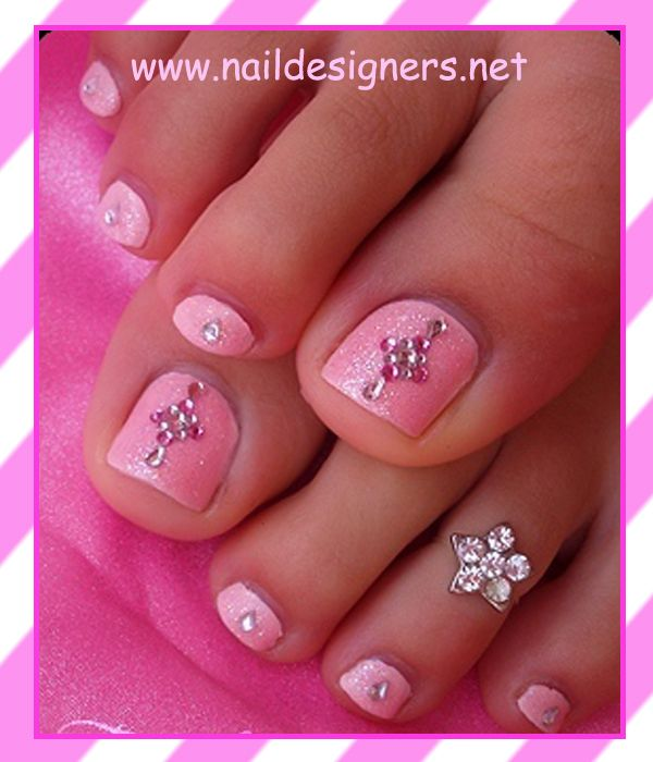 Toe nails with pink bling design