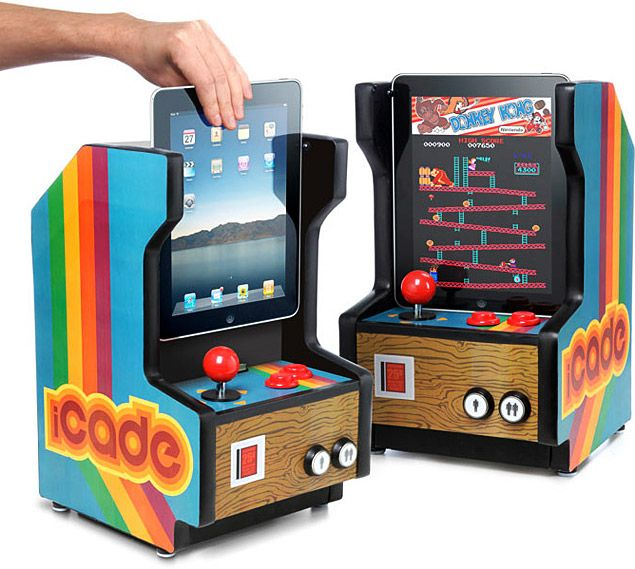 AWESOME!!!! iCade lets you slide your iPad into a retro arcade cabinet dock & play classic arcade games. I WANT!